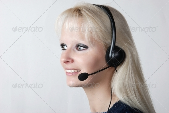Portrait of young woman with headset - Stock Photo - Images