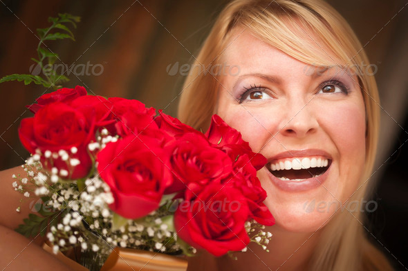 Beautiful Smiling Blonde Woman with Red Roses. - Stock Photo - Images
