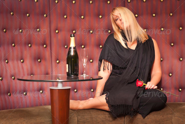 Sensual Beautiful Blonde Woman Sitting Near Champagne and Rose. - Stock Photo - Images