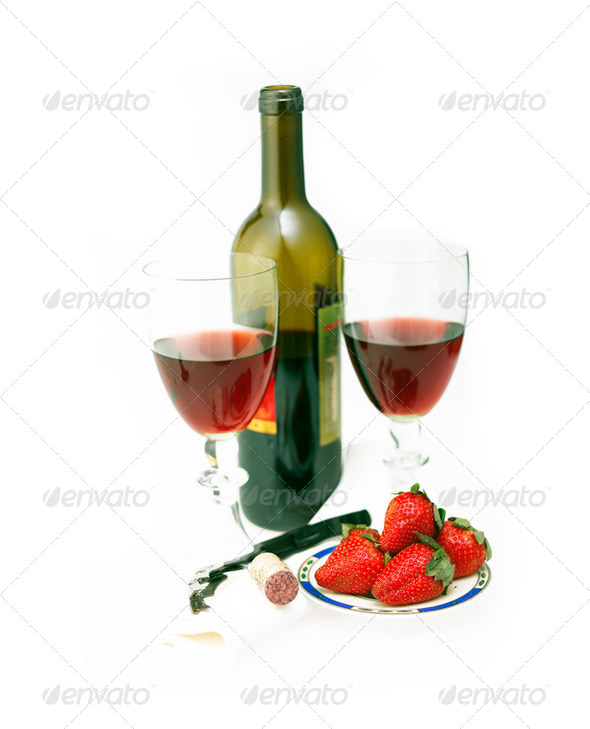 red wine bottle and two glasses with strawberries - Stock Photo - Images