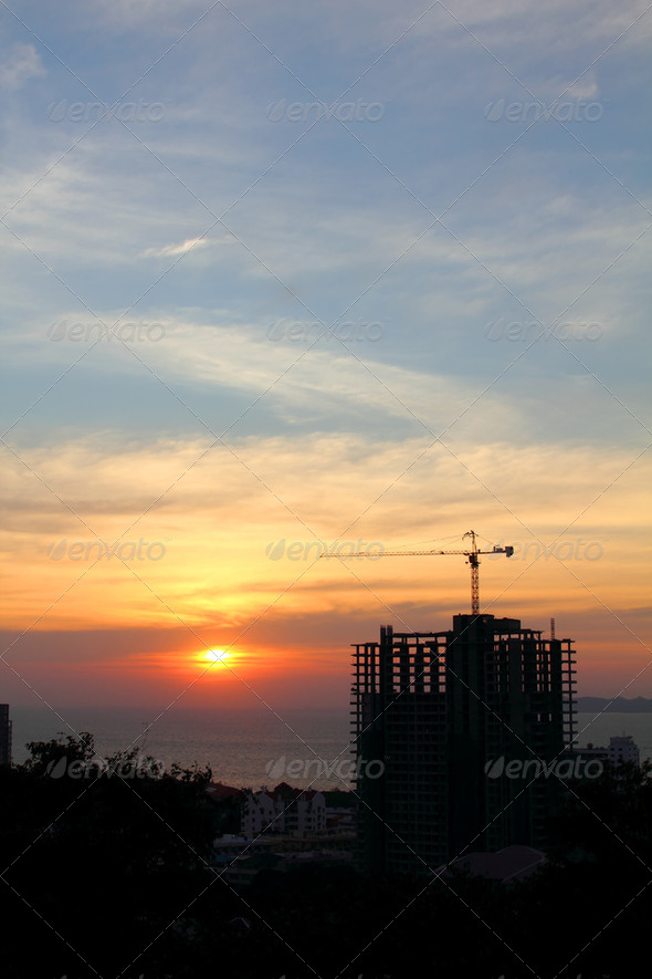buildings under construction with cranes in nature scene sunset 2 - Stock Photo - Images