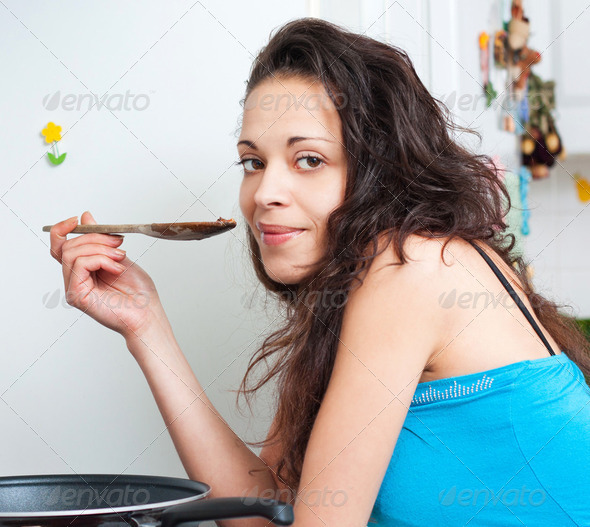 Attractive brunette tasting - Stock Photo - Images