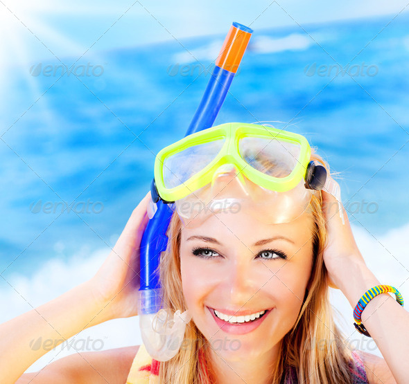 Cute teen girl having fun on the beach - Stock Photo - Images