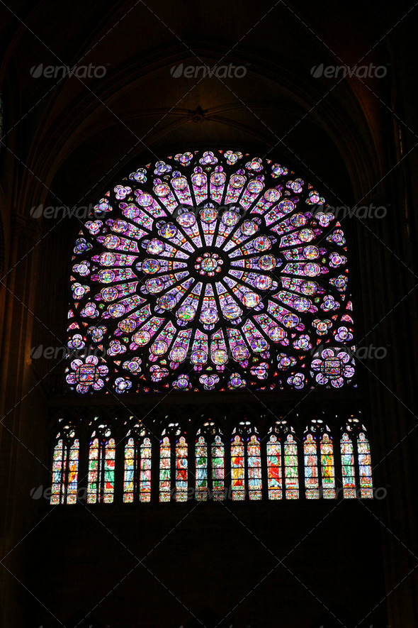 Stained glass window of the Notre Dame - Stock Photo - Images