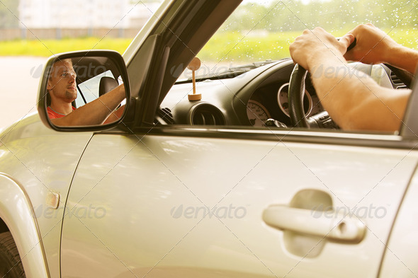 young man in car - Stock Photo - Images
