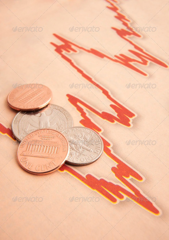 coins on graph paper - Stock Photo - Images