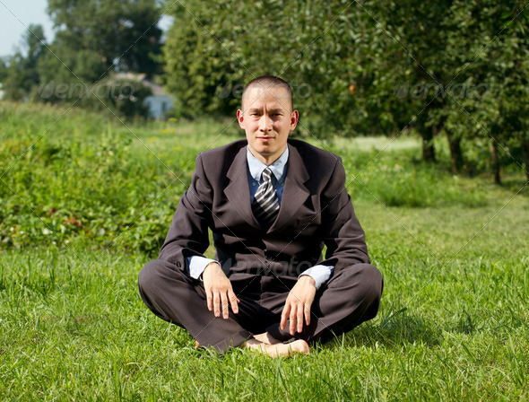 Businessman Meditating Outdoors - Stock Photo - Images