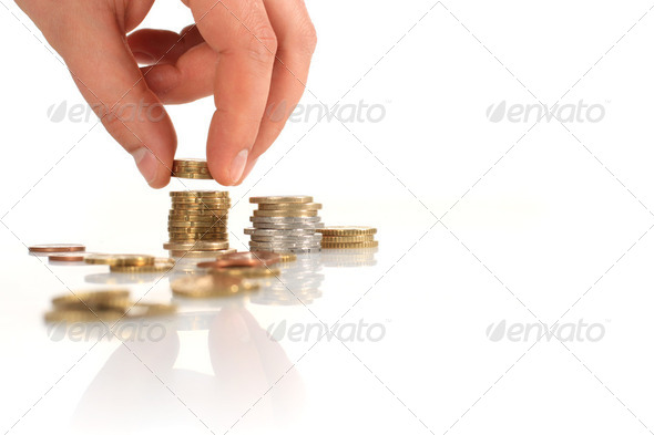 Euro coin in hand. - Stock Photo - Images
