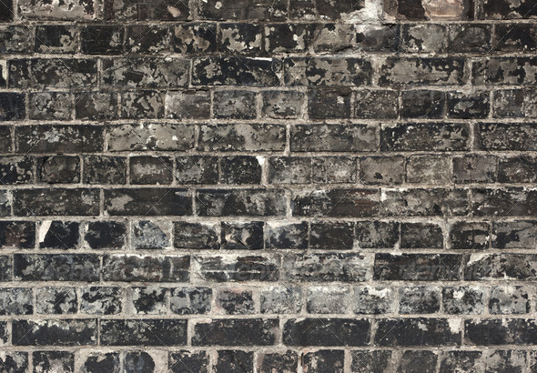 Old weathered black brick wall texture close up. - Stock Photo - Images