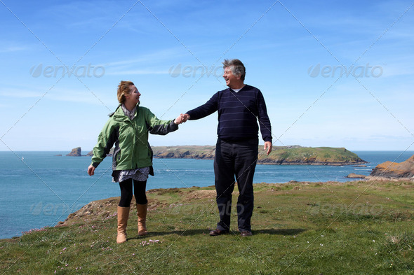 Mature couple on the coastal path - Stock Photo - Images