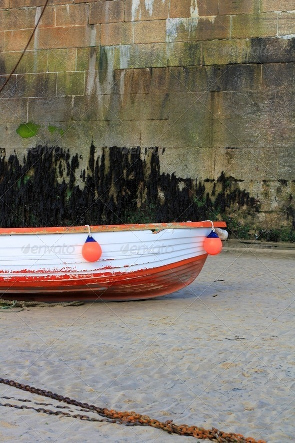 Red and White Wooden Boat with Buoys and Chain - Stock Photo - Images
