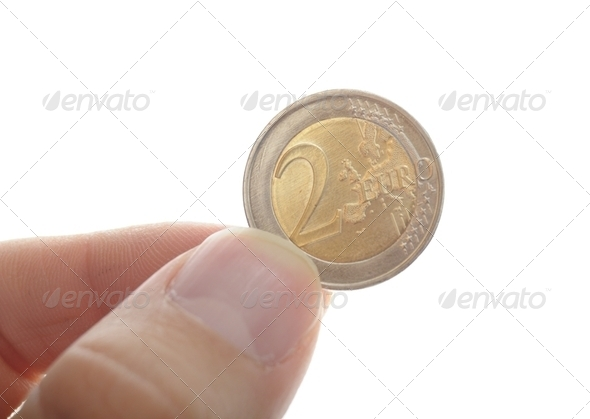 hand holding two euro - Stock Photo - Images