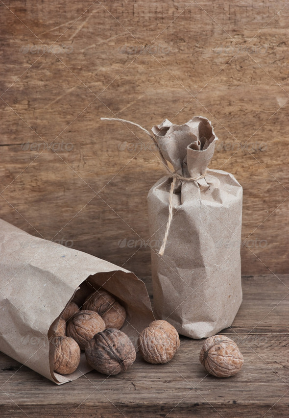 walnuts in a kraft paper bag - Stock Photo - Images