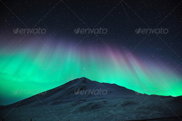 aurora borealis over mountain - Stock Photo - Images