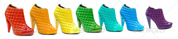 Variety of all rainbow colors in patent leather shoes or boots a - Stock Photo - Images
