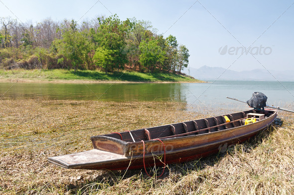 Wooden boat in a cypress swamp - Stock Photo - Images