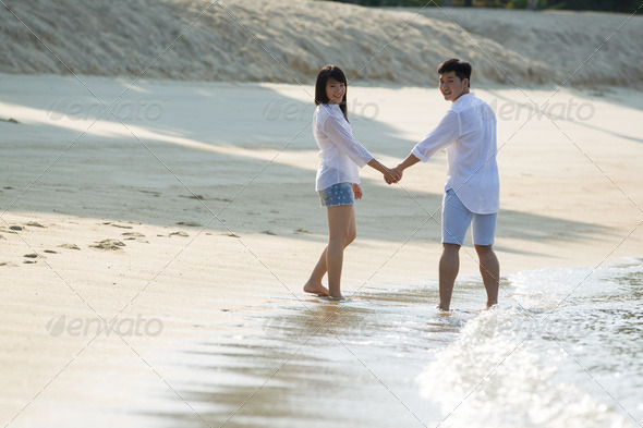 Asian couple on the beach. - Stock Photo - Images
