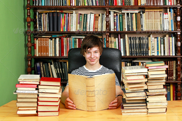 Teenager in library - Stock Photo - Images