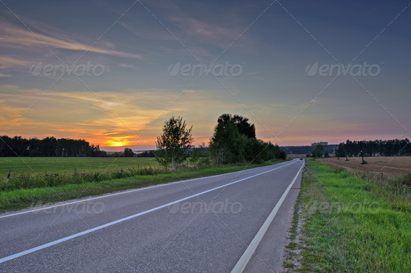 Asphalt road in sunset light - Stock Photo - Images