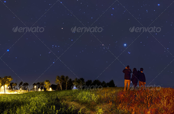 Looking at the stars with binoculars - Stock Photo - Images