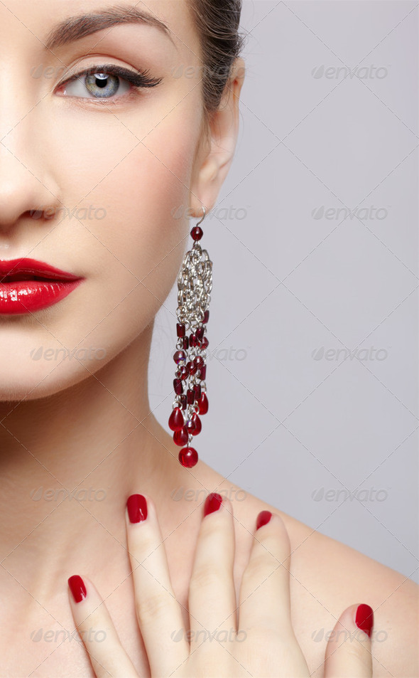 beautiful woman in ear-rings - Stock Photo - Images