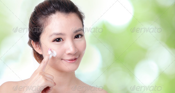 woman washing face with foam on green - Stock Photo - Images