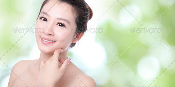 Young woman smile and hand touch face - Stock Photo - Images