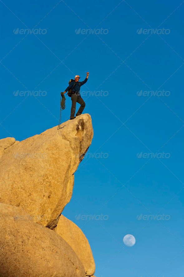 Climber on the summit. - Stock Photo - Images
