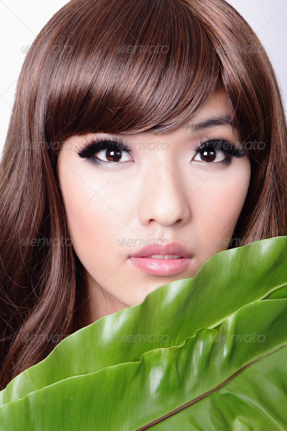 Woman face and green leaf - Stock Photo - Images