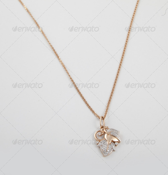 Golden pendant - Stock Photo - Images