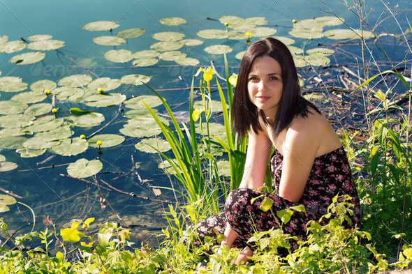 Young woman by the pond - Stock Photo - Images