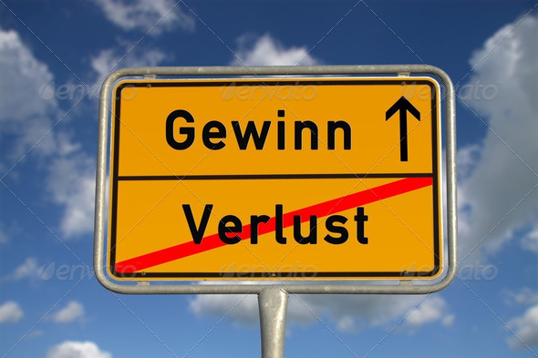 German road sign deficit, and profit - Stock Photo - Images