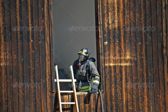 firefighter with mask off a dangerous fire - Stock Photo - Images