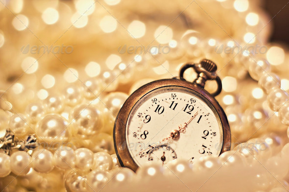 Antique watch and pearls - Stock Photo - Images