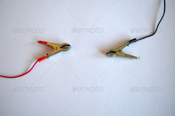 Accumulator battery charger connectors clamp. Plius and minus - Stock Photo - Images
