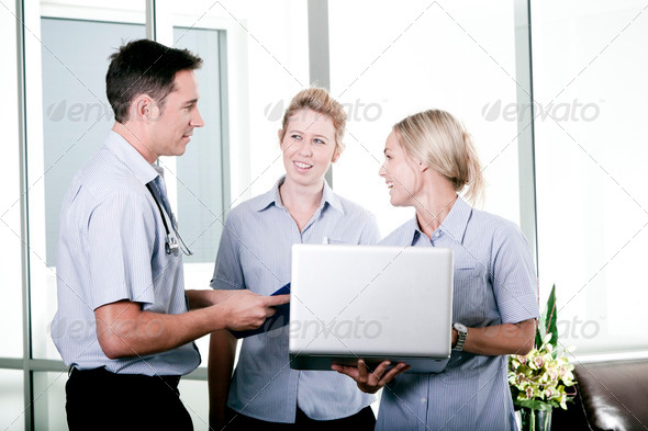 Young doctor with two nurses - Stock Photo - Images