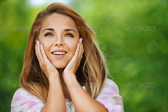 beautiful smiling young woman - Stock Photo - Images