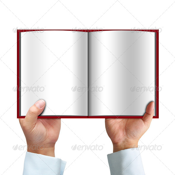 Opened book in hand - Stock Photo - Images