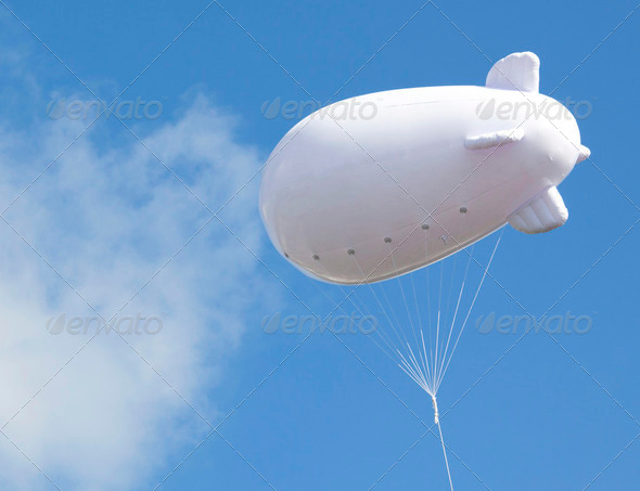 Advertising balloon with free space high in he sky - Stock Photo - Images
