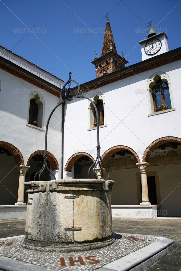 cloister of the convent with the ancient well  in Italy - Stock Photo - Images