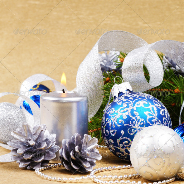 Blue and white christmas balls with silver candle - Stock Photo - Images