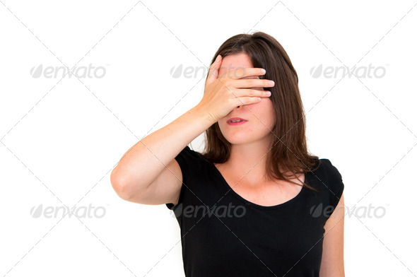 woman shuts face with hands - Stock Photo - Images