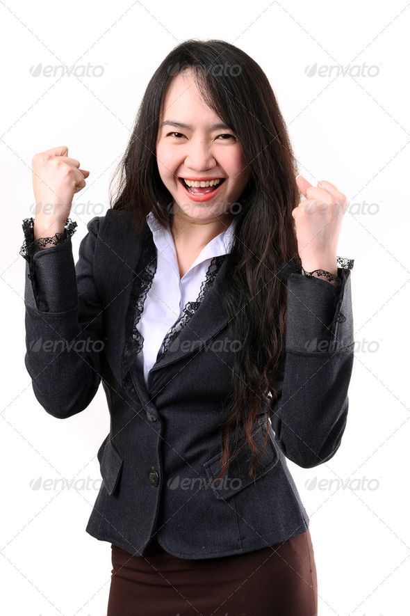 Winning success woman happy ecstatic celebrating being a winner - Stock Photo - Images