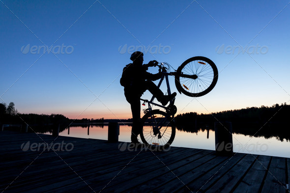 Silhouette of a Cyclist on the Sunset Sky - Stock Photo - Images