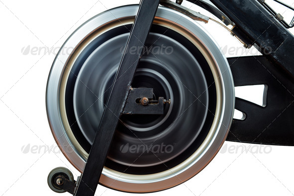 Aged Spinning Bike Flywheel Rotating. Front detail.  - Stock Photo - Images