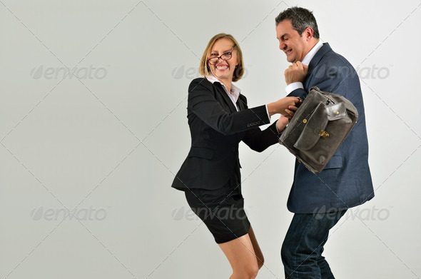Angry executive woman with bag hit scared business man isolated - Stock Photo - Images