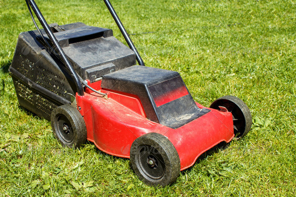 Lawnmower on grass - Stock Photo - Images