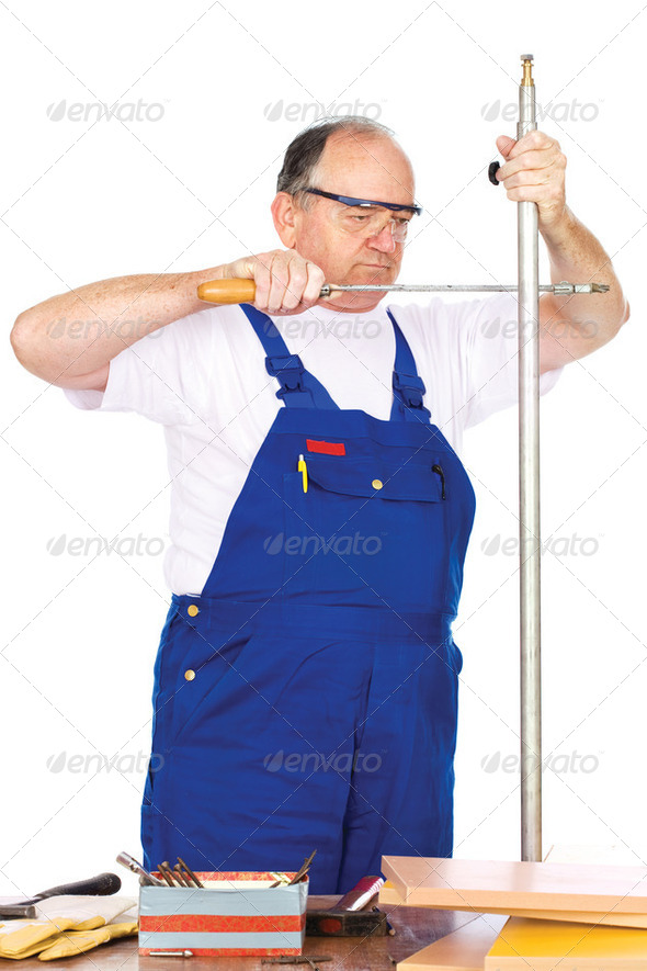 Middle age worker cutting metal pipe - Stock Photo - Images