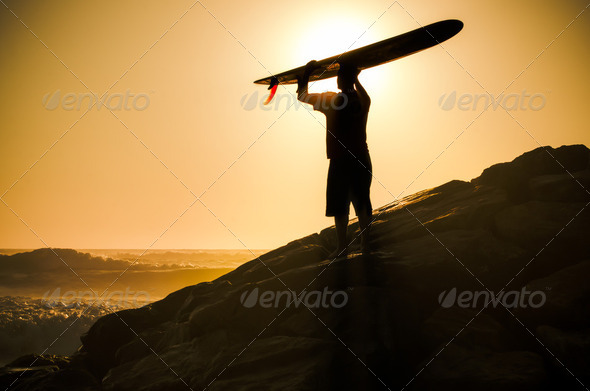 A longboarder watching the waves - Stock Photo - Images