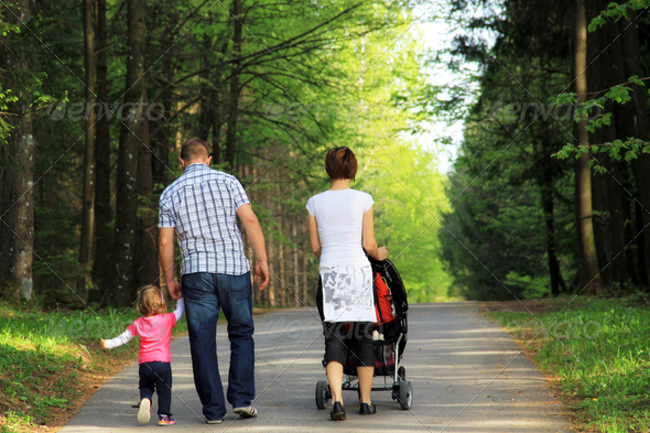 Young family in the park - Stock Photo - Images